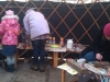 in-yurt-backs-to-us-painting