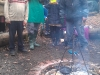 volunteers-and-support-workers-eating-around-the-fire-pit-during-a-session