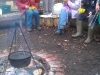 volunteers-eating-around-the-fire-pit-during-a-session